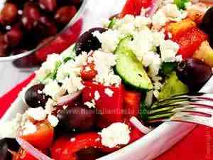 Vegetarian salad with cucumbers, peppers, tomatoes, feta cheese, onions and tomatoes