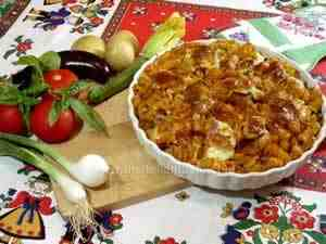 Italian baked pasta with vegetables and mozzarella cheese